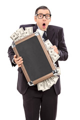 Scared businessman holding a bag full of money