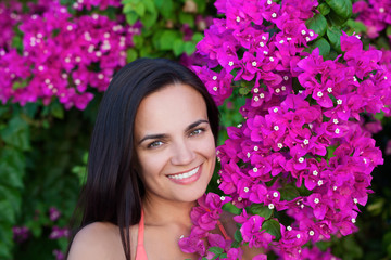 portrait of young beautiful woman girl in bougainvillea
