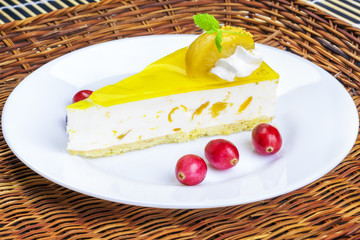 Apple cream cake with cranberries on a white plate