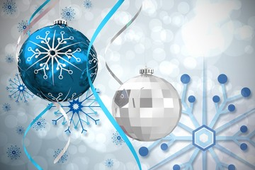 Composite image of hanging christmas bauble decorations