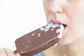 Woman eats ice cream with chocolate