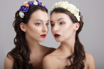 Inspiration.Two Styled Females with Wreaths of Flowers
