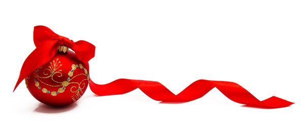 Red christmas ball with ribbon on a white background