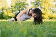 Young woman portrait practicing push up exercise outdoors in a p