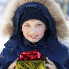 boy with gift outdoors
