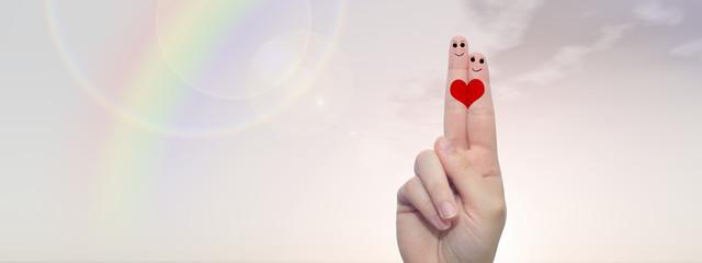 Fingers in love over sky banner