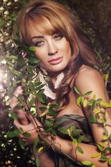 Beautiful woman in autumn scenery