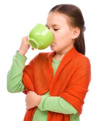 Cute girl is drinking tee