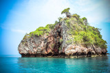 Hut on a limestone cliff in the Andaman Sea - 71642990