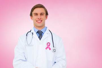 Composite image of young doctor using tablet pc