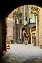A woman walks in a street