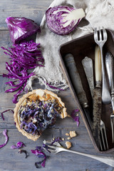homemade purple cabbage quiche and vintage box with silverware