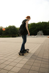 Beauty Girl Skating in gardens