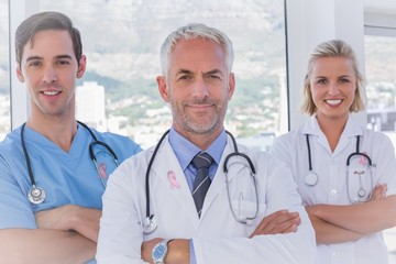 Composite image of group of doctor and nurses standing together