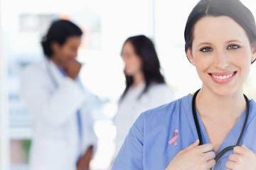 Composite image of confident nurse standing