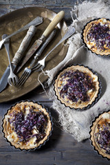 homemade purple cabbage quiche and vintage tray with silverware
