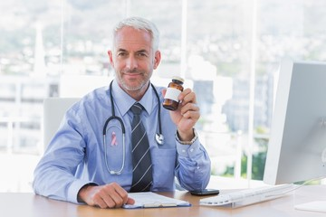Composite image of doctor holding medicine jar