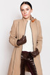 Young beautiful woman in a stylish coat