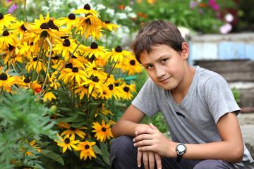 boy against summer flower