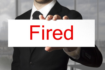 businessman showing sign fired