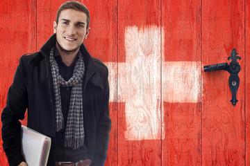 Student vor Schweizertüre