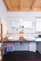 modern new bath room with two basins in timber house