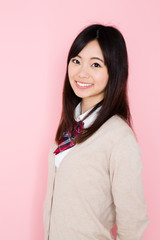 young asian woman on pink background