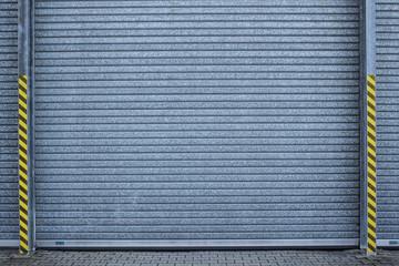 Hintergrund verinktes Stahltor (roll-up door)