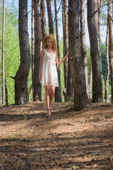 Beautiful woman walking in forest