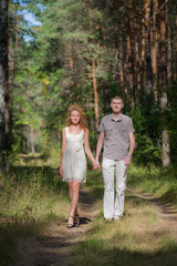 Hapy Young Couple Walking in forest
