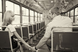 young guy to get acquainted with a cute girl in the tram