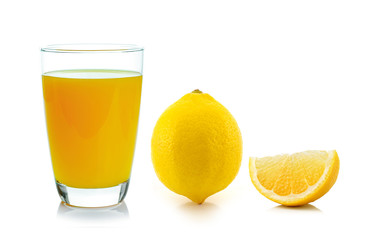 lemon juice in a glass and lemon isolated on white background