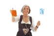ältere Frau in bayrischer Tracht und Souvenirs