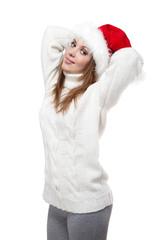 Beautiful woman wearing a santa hat smiling