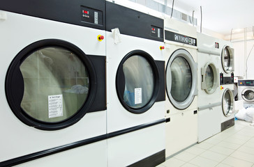 Close-up on rotating drums of washing machines