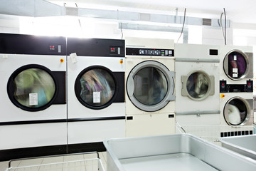 Image of working washing machines in laundry room