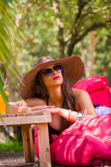 Pretty woman relaxing outdoors