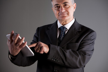 Senoir man using successfully a tablet