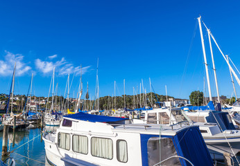 Marina with yachts and boats in beautiful blue sky day.
