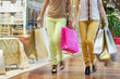 Two women walking with shopping bags in hands - 71652133