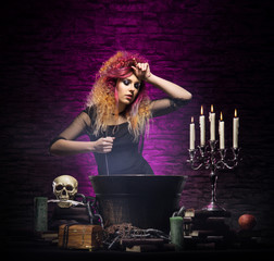 Witch making witchcraft on a smoky Halloween background