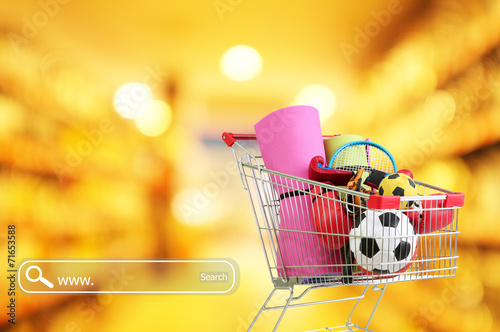 Shopping concept. Shopping cart with sport equipment - 71653588