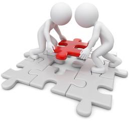 zwei Männchen mit passendem Puzzleteil