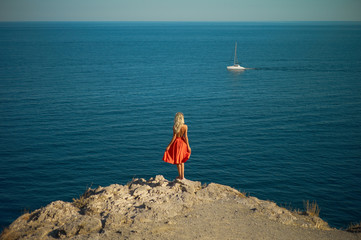 Young woman waiting for sailboat