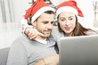 happy couple buying online presents