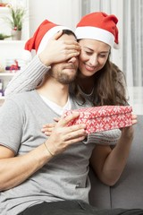 girl suprise boyfriend with christmas gift