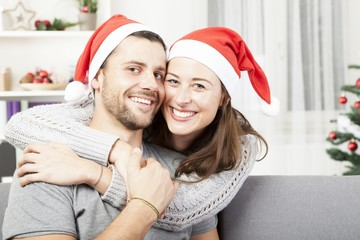 young happy couple hug and love christmas