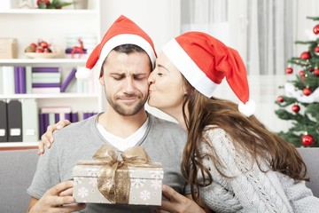 boyfriend looks skeptical to his christmas gift