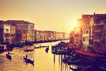Venice, Italy. Gondolas on Grand Canal at gold sunset. Vintage