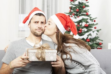 man is sceptical about christmas gift